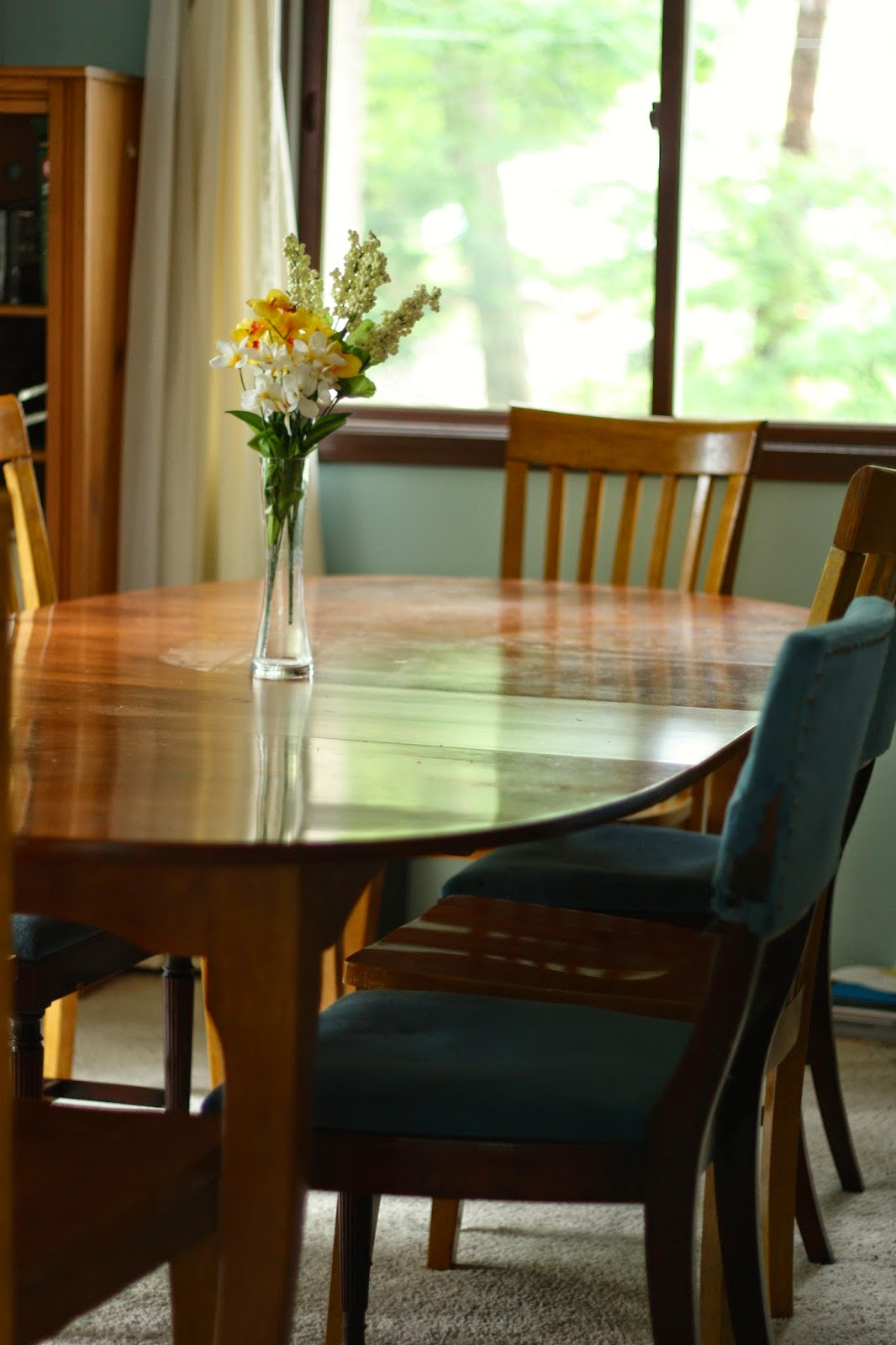 Dining room table with window behind it