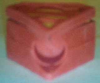 Bottom view of Superman S shield pencil top eraser from vending machine