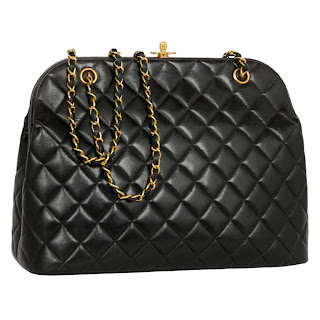 Vintage 1980's black quilted leather Chanel doctor bag with gold clasp hardware and chain straps.