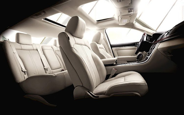 Interior shot of 2011 Lincoln MKS with cream leather interior and sunroof