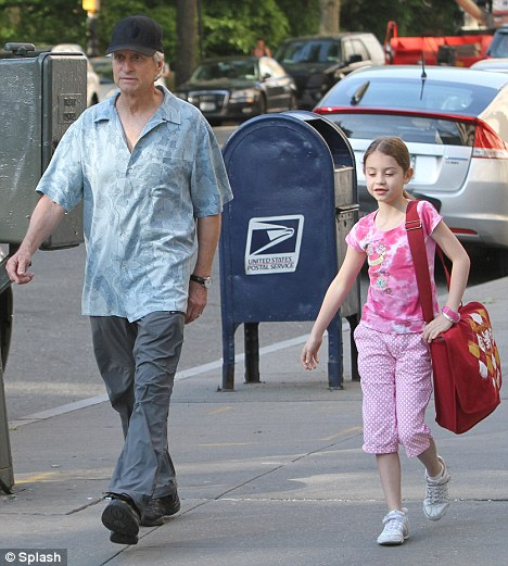 Fighting fit: Michael Douglas healthier and stronger as he walks daughter Carys to school