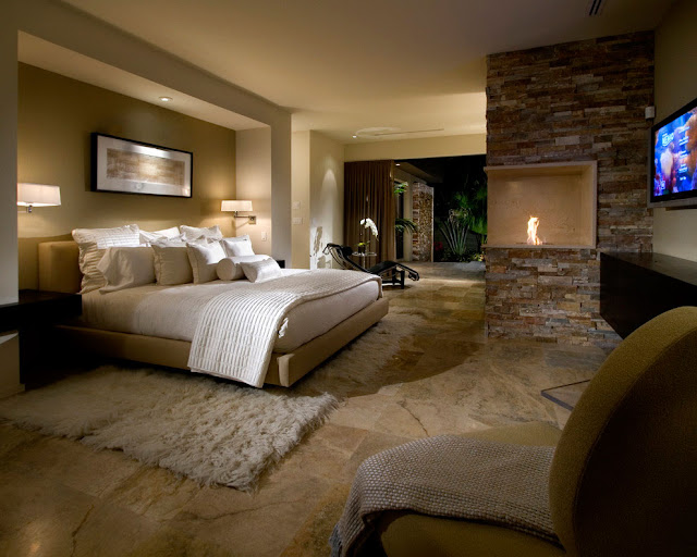 Traditional bedroom with fireplace