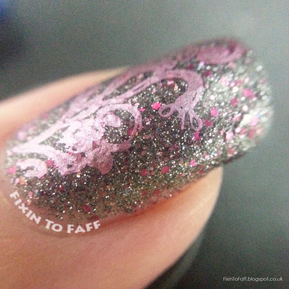 Festive colored chrome stamping over Nail Pattern Boldness Clairvoyant Visitor macro.