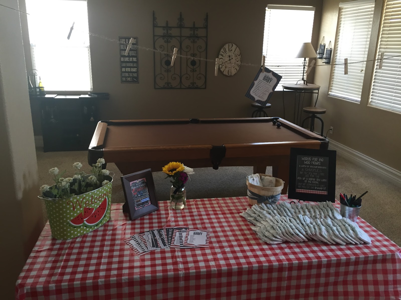 When you first walk into the house there was a table set up with a few  activities for the guests. We had diapers with a cute poem about writing  Katie a ...