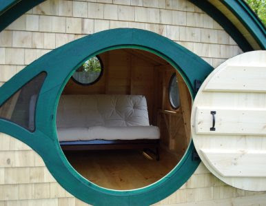 hobbit house with door open and futon inside