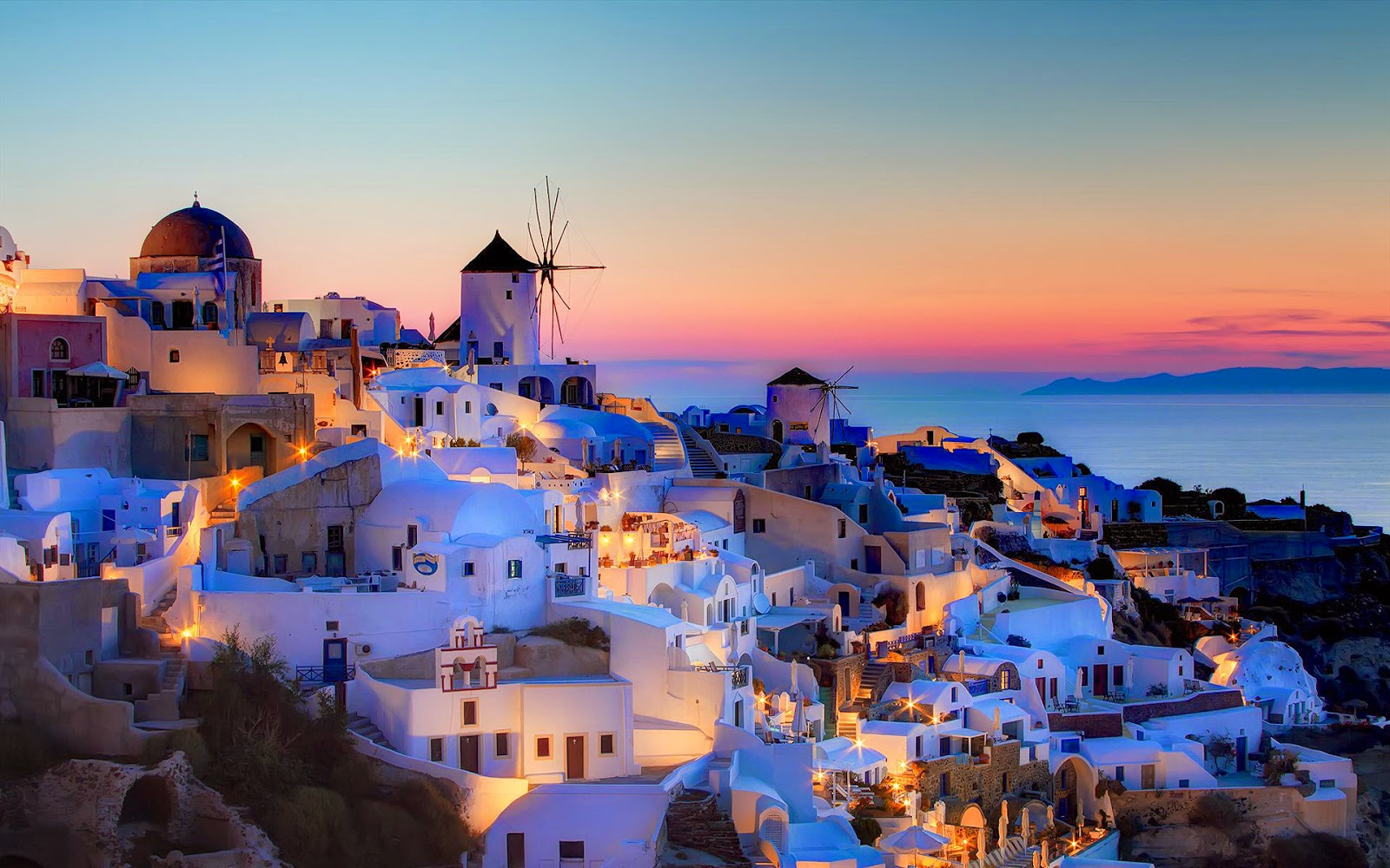 Viagens mais desejadas depois que crescemos um dos lugares mais lindos do mundo com casas caiadas de branco domos azuis a beleza agressiva da cratera e o sol a afundar no mar thecheapjerseys Gallery