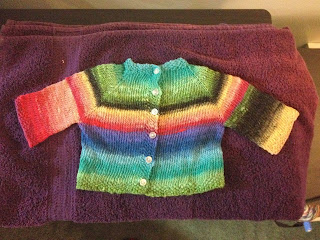 Rainbow baby sweater She knits in Pearls.
