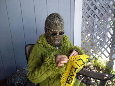 "Cynthia Parkhill crochets yarnstorming tag: ""Support Libraries"" in Hebrew"