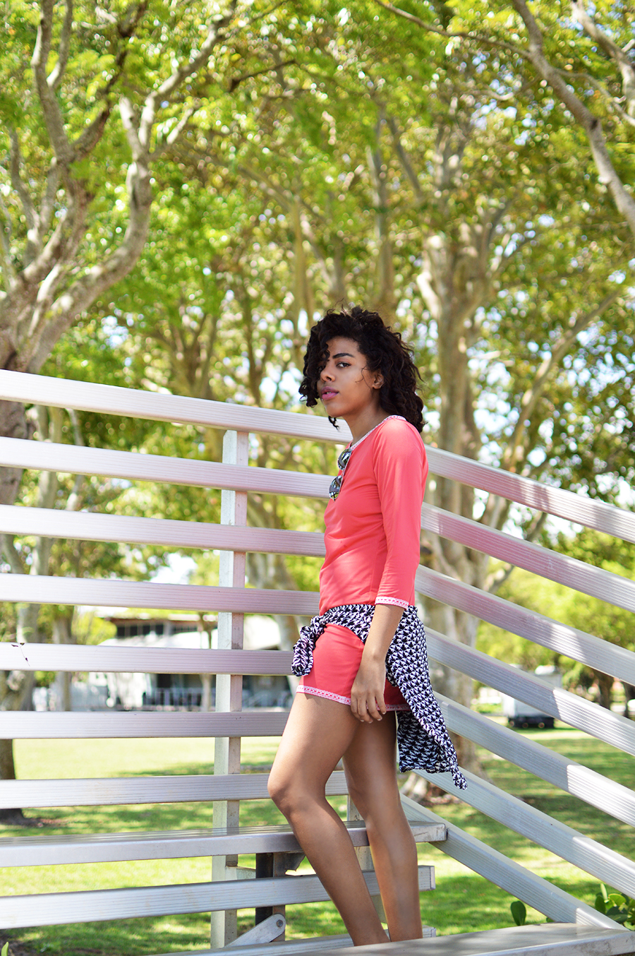 indie fashion blogger anais alexandre of down to stars in a coral dress with white vans on in the park