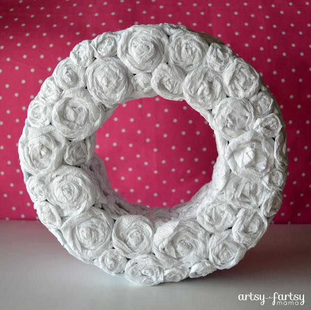 Crepe Paper Rosette Wreath at artsyfartsymama.com #wreath