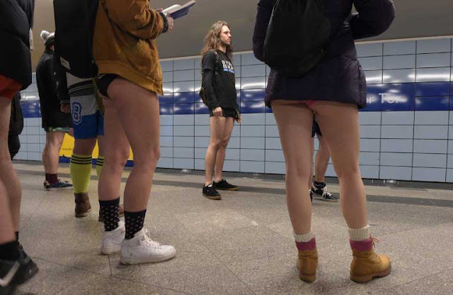 Travellers removed their trousers and rode subways in their underwear as part of the 'No Pants Subway Ride' on Sunday.  In over 60 countries, from USA to Australia commuters removed their pants and got into the trains. Over 4,000 participated in New York alone.  They braved bitter cold in many places.