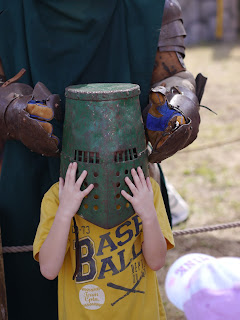 Child trying on Armor at Renaissance Festival in Deerfield Beach