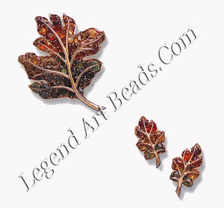 Leaf brooch and matching earclips in multicolored zircons