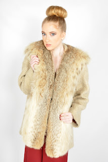 Vintage 1960's oatmeal colored wool and lynx fur collared swing coat.