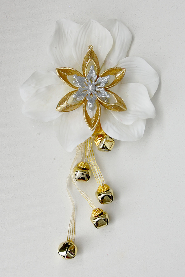 white and gold ornaments, white flower, gold bell