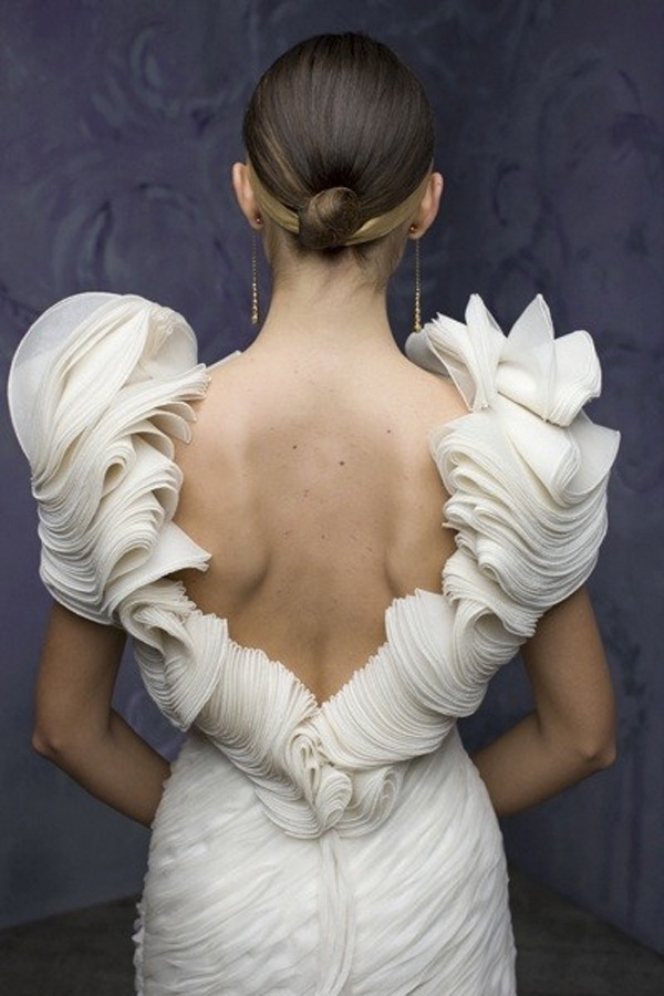 St. Pucchi ruffled wedding gown via www.lemagnifiqueblog.com