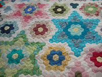 http://quiltingrdh.blogspot.com/2012/11/hexagon-quilt-progress.html