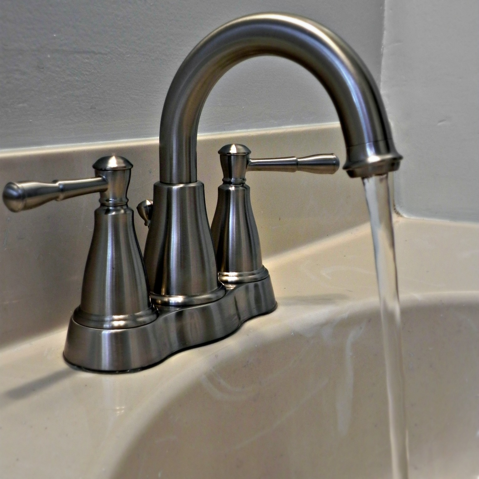 ... brass faucets in the house with a more updated brushed nickel piece