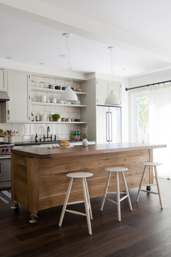 Sturdy wooden kitchen island on wheels designed by Simo Design and DM/DM via remodelista (photo by David Gilbert)