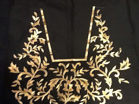 Black blouse embroidered with gold zari embroidery