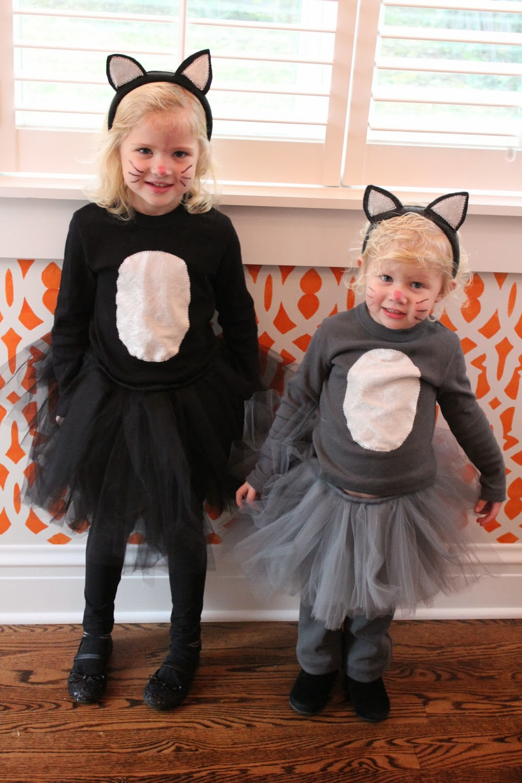 made our halloween costumes again this year marin wanted to be a cat so of course emilie then wanted to be a cat so we made john a mouse adorable