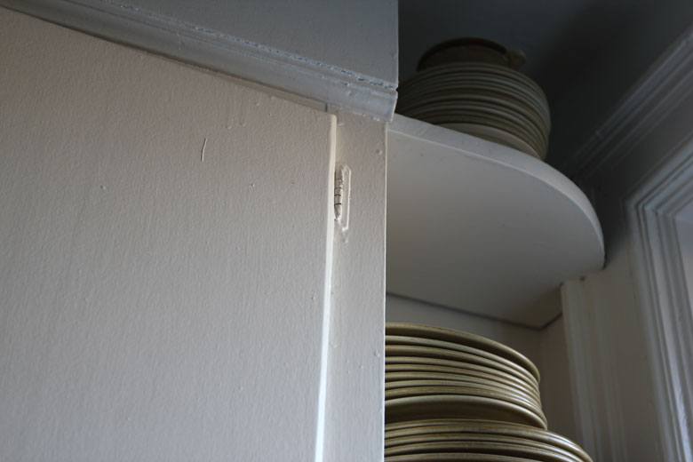 wardens lisa diquinzio michael leblanc toronto apartment interior stacked dishes kitchen shelving ceramic plates