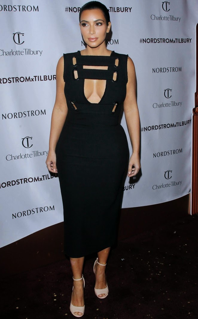Kim Kardashian flaunts cleavage in a cutout dress at the Nordstrom x Charlotte Tilbury Make Up Launch