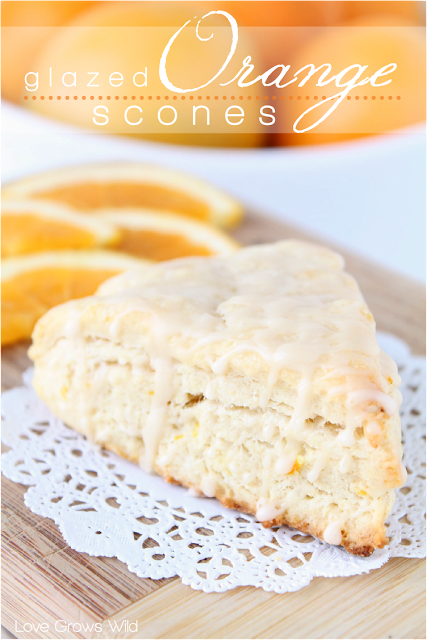 Glazed Orange Scones - a delicious citrusy scone drizzled with an orange vanilla glaze! at LoveGrowsWild.com