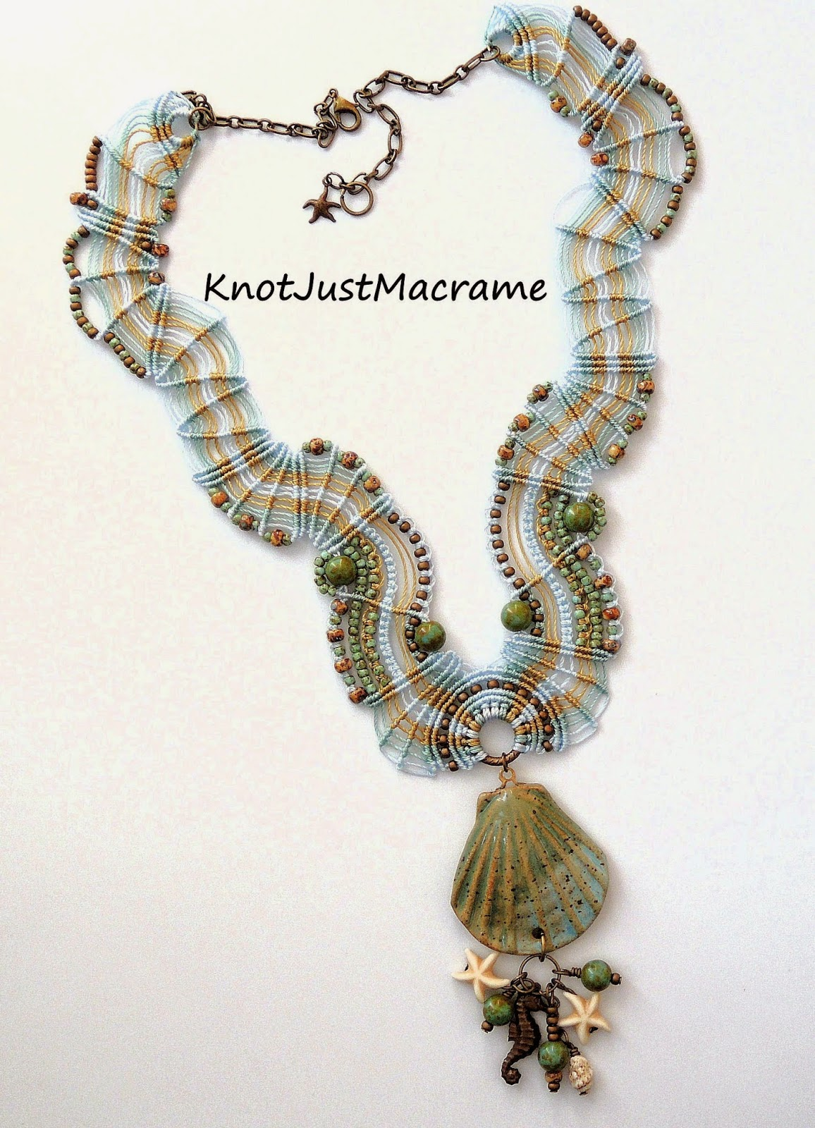Micro macrame necklace by Sherri Stokey with ceramic shell pendant by Firefly Design Studio