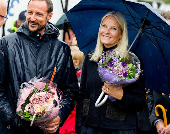 Crown Princess Mette-Marit of Norway and Crown Prince Haakon of Norway visit Drobak town square on an official county visit to Akershus