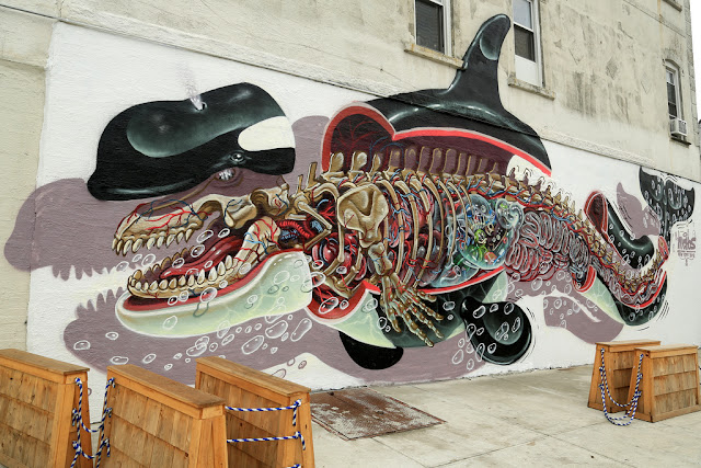 street art by Nychos in new york city usa - eight most popular mural of 2013