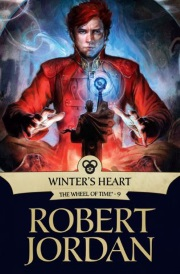 Cover of Winter's Heart, featuring a young, red-haired white man in a red coat seated before an idol topped with a glowing blue orb.