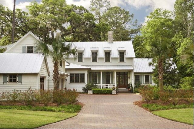 metal roof and gray shutters white siding