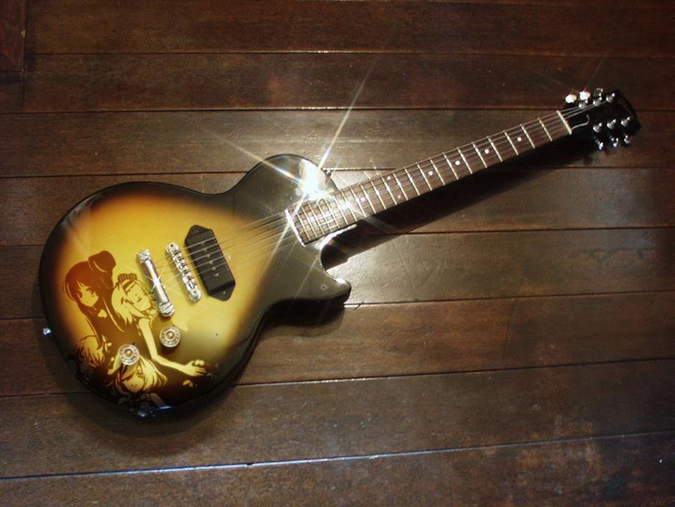 Guitarras pintadas con dibujos anime. 297236_10150310209534819_213182229818_7683195_1279013602_n