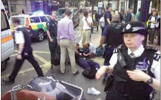 Members of the public holding a suspect down outside selfridges