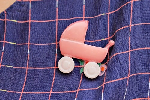 pink vintage plastic baby carriage brooch
