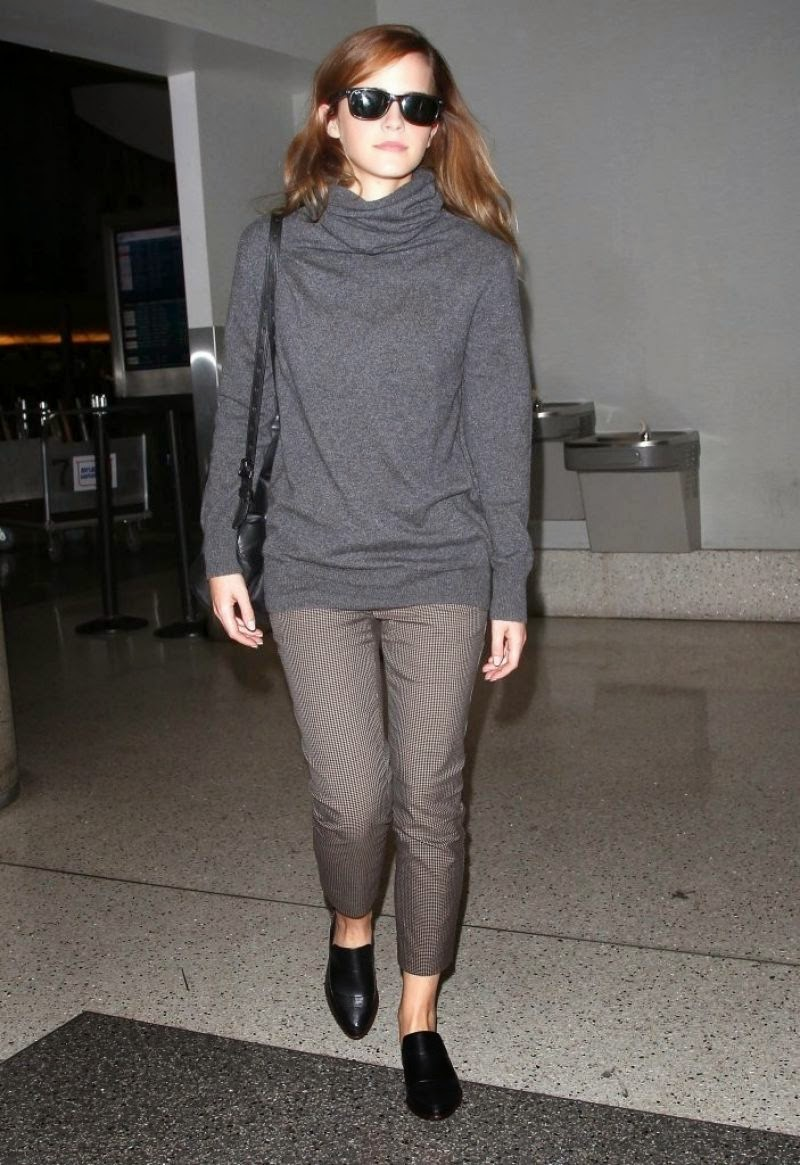 Emma Watson arrives at LAX airport in a chic casual style
