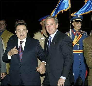 Holding hands: Egyptian President Hosni Mubarak welcomes U.S. President