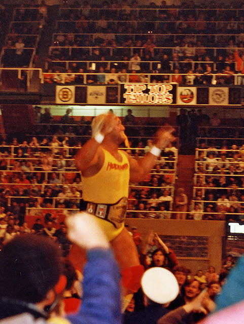 WWF Champion Hulk Hogan marches up the ramp to the wrestling ring at Maple Leaf Gardens in Toronto, December 28, 1986. Hulkster is wearing the new Hogan 1986 wrestling title belt.