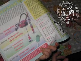 Szöveg: E mellé még kell a ceruza. Kép: Közelkép egy kinyitott rejtvénylapról, aminek a lehajló lapján látszik a megoldandó rejtvény típusa.