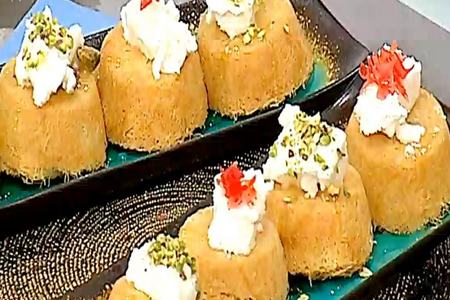 Place half of the kataifi mixture in each cup of the pan Knafeh cupcakes recipe
