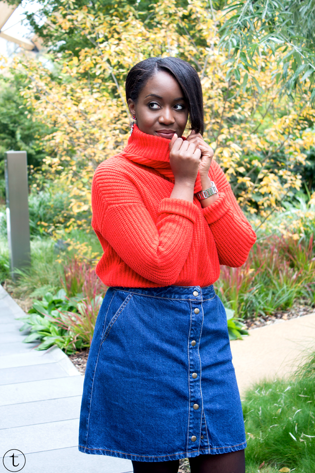 wearing an orange jumper with a jeans skirt from asos