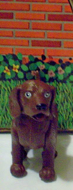 Brown dog packed with Smartees Vicky the Veterinarian, facing
