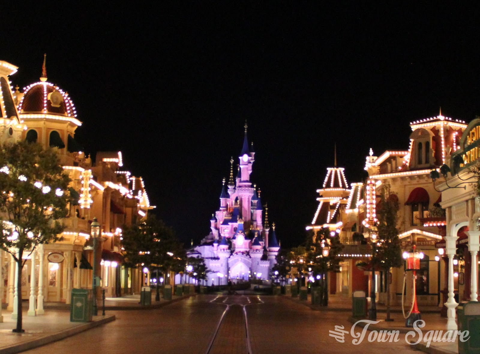 Empty Main Street USA at night.