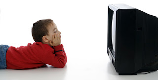 young boy zoned out in front of the TV