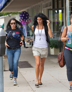 Angie Harmon  running on the street