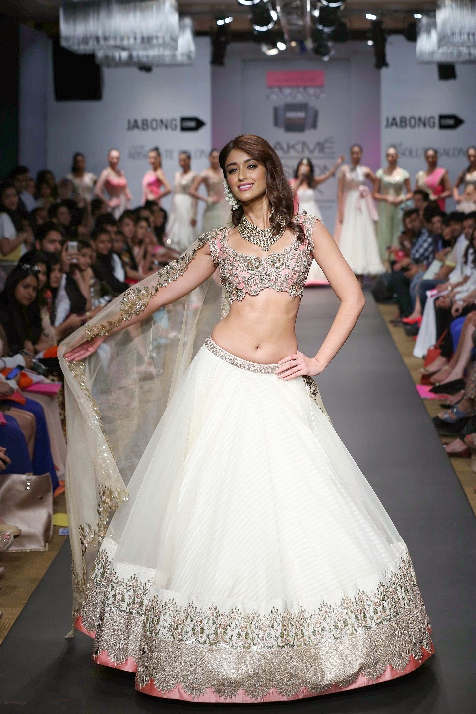 Ending the show was beautiful Ileana D'Cruz who stunned all in a ravishing cream lehenga and peach toned blouse with sequins and embroidery.