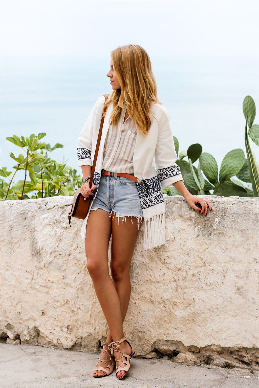 embroidered fringe kimono, vintage Levis cutoffs, tan accessories, lace-up sandals
