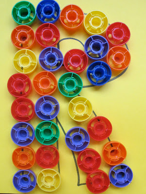 Recycled lids for use with letter recognition