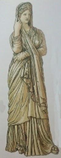Pudicita,  personificación  de la modestia y la castidad, se cubre la cabeza con discrección